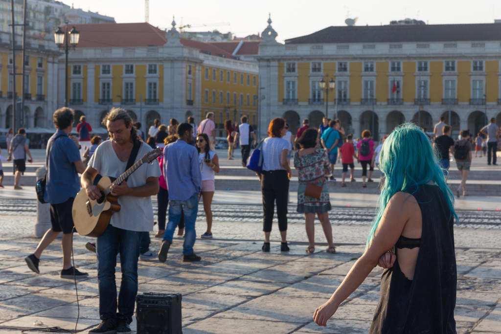 A man busking on Lisbon's Praça do Comércio