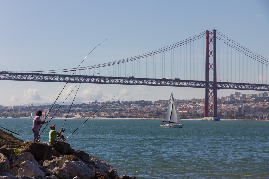 Lisbon and 25th of April bridge seen from other side of the river