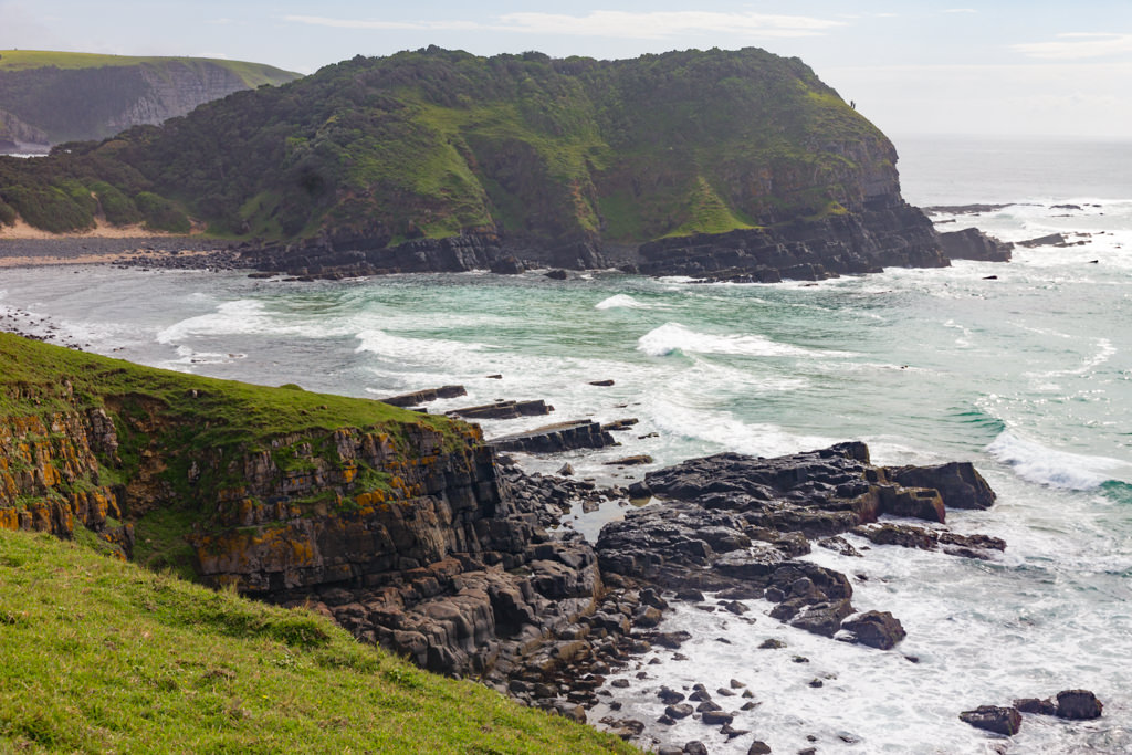 Rocky shores and green hills along South Africa's wild coast