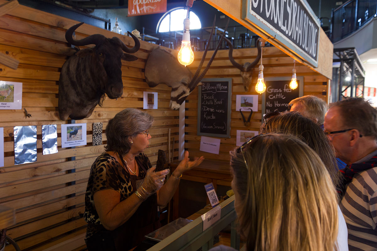Woman selling ostrich and game meat at the V&A food market in Cape Town
