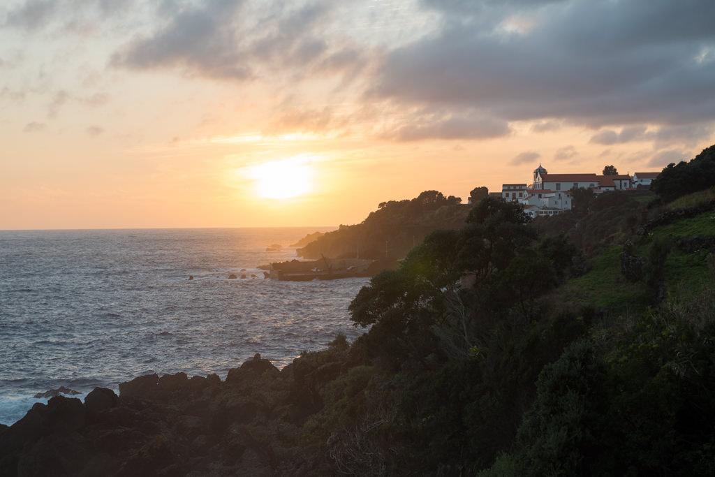 Orange sunset along the coast of Pico Island