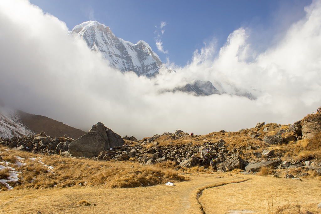 Snow-capped mountain hidden behind clouds in Nepal