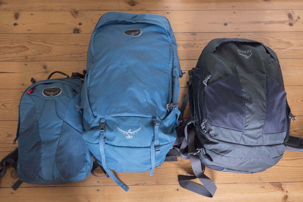 Osprey Farpoint 55 with detached daypack next to a Farpoint 40